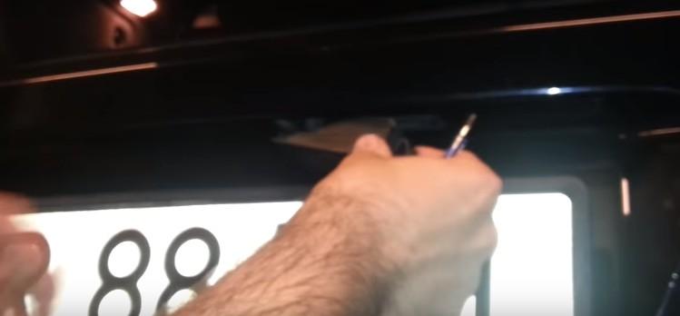 Плафон подсветки номера Опель Астра H